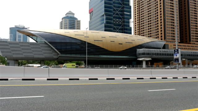 Time lapse of Dubai Street car traffic and metro station video