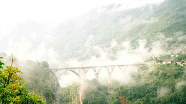 Time lapse of fog over Bridge on Tara river video