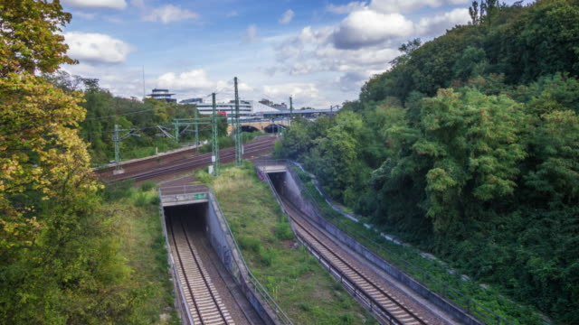 Time lapse of German trains by a trafficked train station video