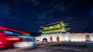Time lapse of Gyeongbokgung palace and traffic at night in Seoul,South korea. video