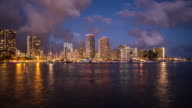 4K - Time lapse of Honolulu downtown with water front at night video