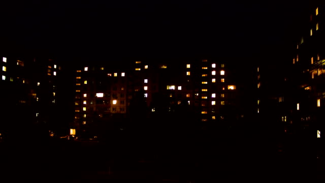 Time lapse of multistorey building with changing window lighting at night video
