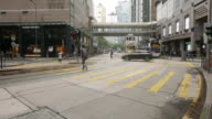Time lapse of people and vehicles at pedestrian crossing intersection on busy road video