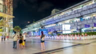 Time lapse of people in front of shopping mall and sky train station background video