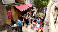 UNITED KINGDOM, LONDON - JUNE 15, 2015: Time lapse of people walking around a restaurant, bar and pub in London city video