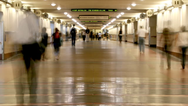 time lapse of people walking through hallway video
