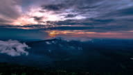 Time lapse of sunrise with mist and clouds moving. video