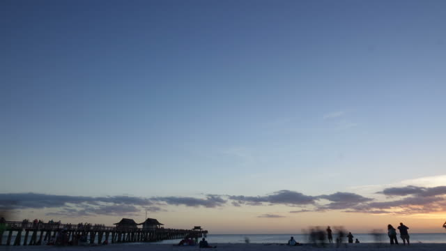 Time Lapse of Sunset in Clouds Over Pier video