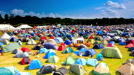 Time lapse of tents blowing in windy field at festival video