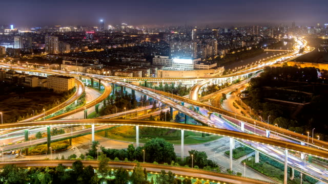 Time lapse of the busy interchange traffic at night in city video