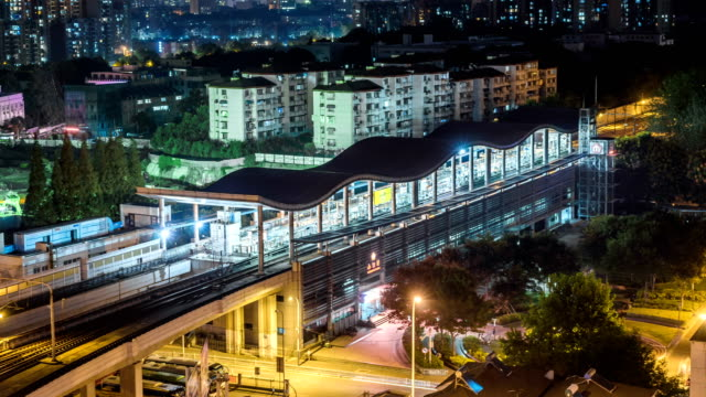Time lapse of the busy interchange traffic station at night in city video