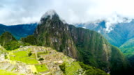 Time lapse of tourists in Machu Picchu and the clouds at the mountain video
