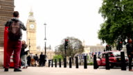 Time lapse of tourists making pictures with the famous london phone box and big ben, London video