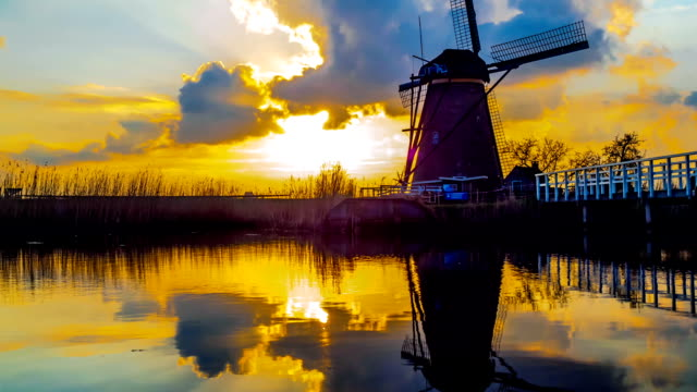 Time lapse of windmill and reflection at sunset video