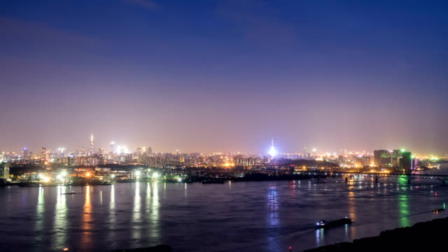 Time lapse of yangtze river skyline in nanjing city,china ,from day to night video