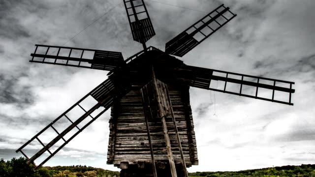 time lapse old windmill on the background of dramatic clouds video