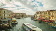 Time Lapse: Panning shot, View of Grand Canal from Rialto bridge with gondolas in Venice. Italy video