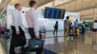 Time Lapse : Passengers at airport departure information board video