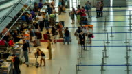 HD Time Lapse : Passengers checking in at the airport video