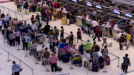 HD Time lapse : Passengers in a row to check in at airport video