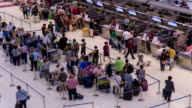 HD Time Lapse : Passengers in airport check in zone video