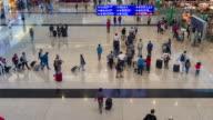 Time Lapse : Pedestrians walking in the airport terminal at Hong Kong international airport video