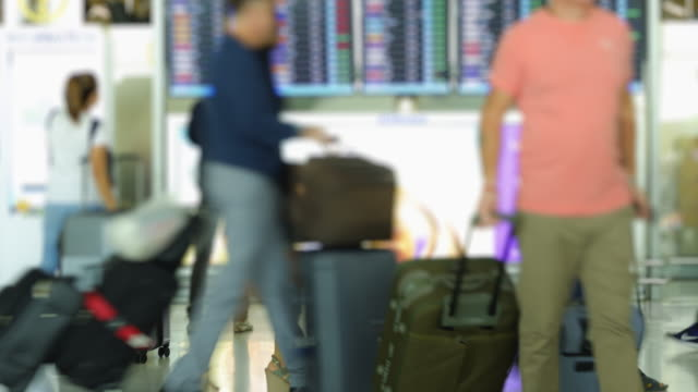 4K time lapse rush hour the crowd checking schedule or buy flight ticket at airport video