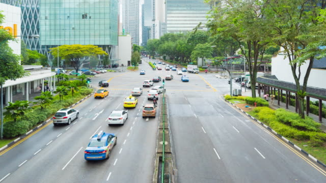 4K Time Lapse : Rush hour traffic and pedestrians in Singapore city video