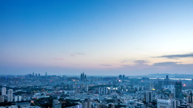Time lapse: Scape aerial view of the Nanjing skyline from day to night rush hour,China video