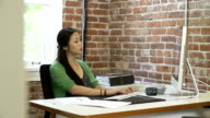 Time Lapse Sequence Of Businesswoman At Desk In Office video