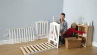 Time Lapse Sequence Of Couple Preparing Nursery For Baby video