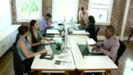 Time Lapse Sequence Of Workers At Desks In Design Office video