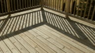 Time Lapse Shadows Moving Across Wooden Deck in Back Yard. video