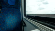 Time lapse shot inside of modern empty train wagon with table, seat places and windows, Vienna, Austria video