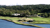 Time lapse shot of a golf course - miniature effect video