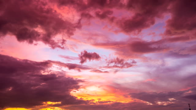 Time lapse shot of Beautiful sunset and orange clouds, dramatic sky video