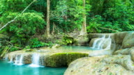 Time Lapse Shot of Clear Water and Flow of Erawan Waterfall , Kanchanaburi, Thailand. Zoom out shot video