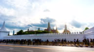 Time Lapse shot of Massive People walking on Road with Thai Temple Background, Bangkok, Thailand. video