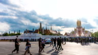 Time Lapse shot of People with Thai Temple, Wat Phra Kaew, Bangkok, Thailand. Crane down shot. video