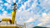 Time Lapse shot of Standing Buddha statue with moving cloud and mountain view. video