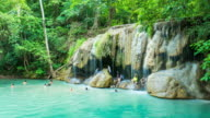 Time Lapse Shot of Tourists at Erawan Waterfall, Kanchanaburi, Thailand, Tilt up shot video