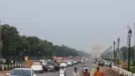 Time lapse shot of traffic on city road, India Gate, New Delhi, India video