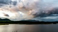 Time lapse - storm clouds above the reservoir_pan shot video