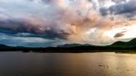 Time lapse - storm clouds above the reservoir_zoom shot (vivid tone) video