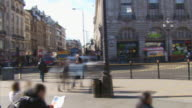 Time lapse street crowds and traffic in city centre video