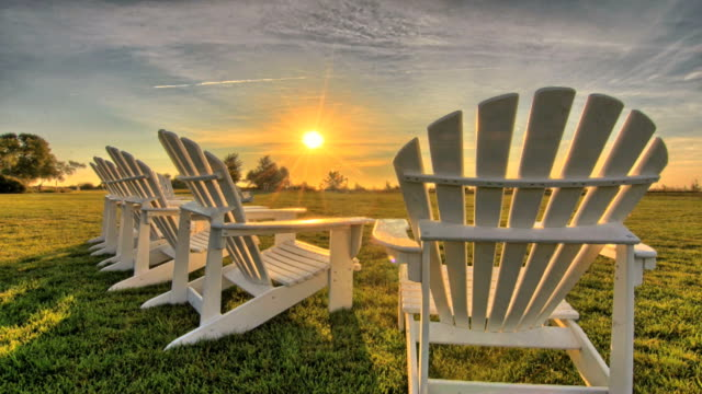 Time lapse sunrise on Mackinac Island, Michigan with Adirondack chairs. video