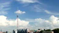 Time Lapse Television Tower against blue sky, curling cumulus clouds fast move video