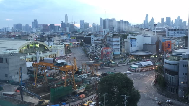 Time lapse: The construction surrounding with traffic and high buildings in business city center video