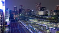 Time lapse - Tokyo trainyard and skyline video