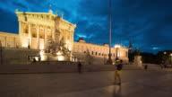Time Lapse, Tourist waking at Austrian Parliament Building at dusk video